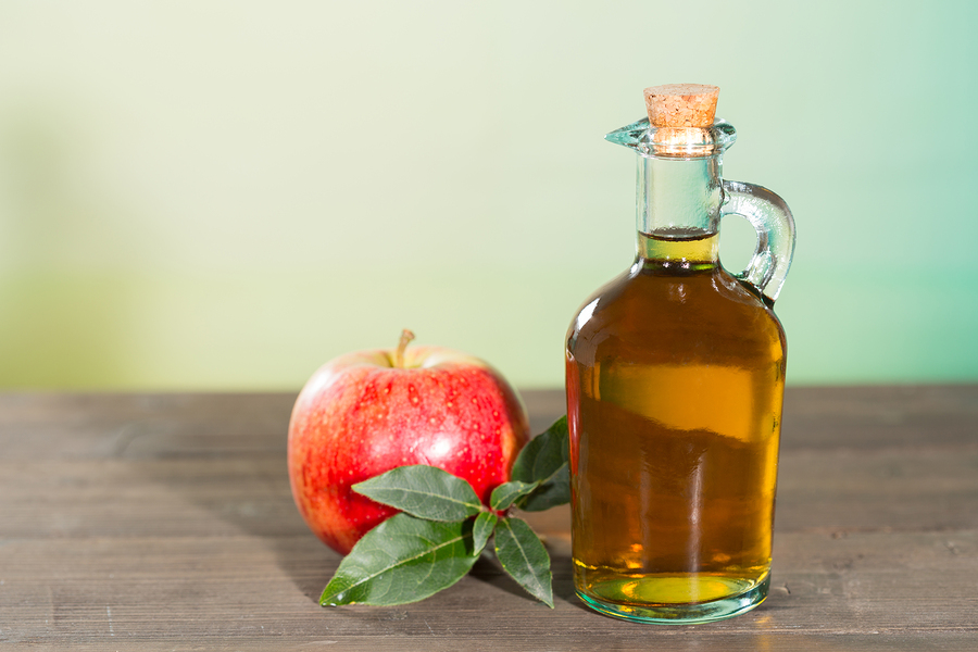 Apple cider vinegar with a fresh apple