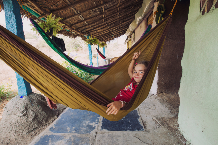 Happy ittle girl resting in a hammock, Hampi, India